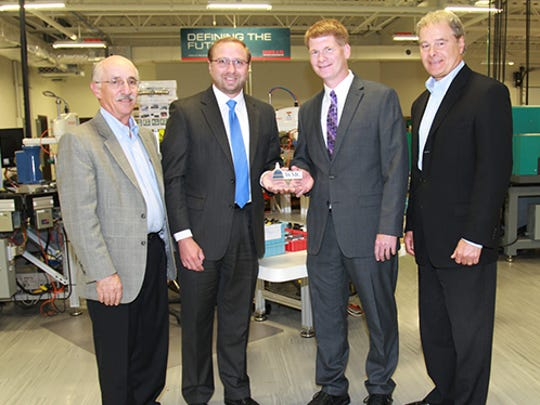 """Wisconsin Manufacturers and Commerce (WMC), the State's Chamber of Commerce, recently honored Rep. Jeremy Thiesfeldt with the prestigious """"Working for Wisconsin"""" Award at Wells Vehicle Electronics in Fond du Lac. The award is given to legislators who stand up for jobs and improve the state's business climate by voting 80 percent or greater in support of the pro-jobs position on the WMC legislative scorecard. WMC reports that Rep. Jeremy Thiesfeldt voted 100 percent to support job-creating legislation. Pictured, from left are Don Lauby, Vice President of Operations, Wells Vehicle Electronics; Chris Reader, Director of Health & Human Resources Policy, WMC; Rep. Thiesfeldt; and David Peace, President, Wells Vehicle Electronics."""