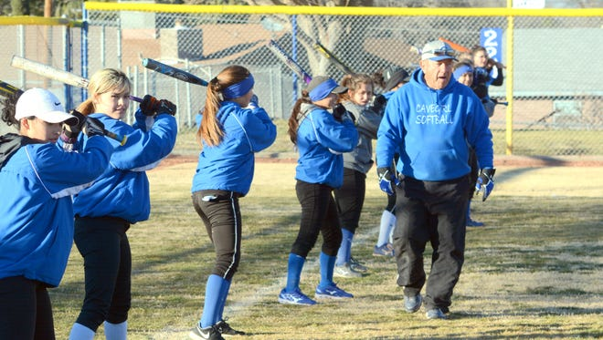Cavegirls coach John Tigert teaches players bunting drills during the first day of practice Tuesday.