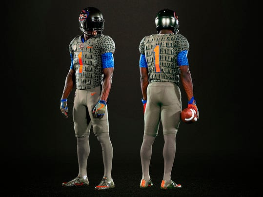 "A undated product image provided by the University of Florida shows the Florida football team's alternate uniform. Coach Jim McElwain jokes that his ""hate mail"" tripled since the uniforms were unveiled earlier this week. The ultimate appraisal comes Saturday night when the unranked Gators (3-2, 3-1 Southeastern Conference) play Texas A&M (4-2, 2-1) at Florida Field, a matchup under the lights that will give the new duds a chance to shine or get shunned. (Tim Casey/University of Florida via AP)"