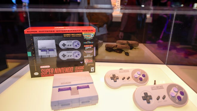 The Super NES Classic Edition on display at the Nintendo Summer of Play event at the Marriott Marquis and Marina on Thursday, July 20, 2017 at San Diego Comic-Con 2017 in San Diego. Splatoon 2 launches on July 21 exclusively for the Nintendo Switch system. (Photo by Denis Poroy/Invision for Nintendo/AP Images)