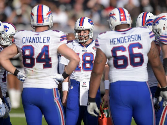 Kyle Orton huddles with his offense during Sunday's game against the Oakland Raiders at O.co Coliseum.