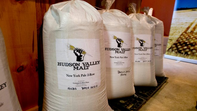 In this Wednesday, March 2, 2016 photo, sacks of malted barley are lined up at Hudson Valley Malt in Germantown, N.Y. The thirst for craft beer and whiskey is creating a new market for smaller-scale regional malt houses as well as a new high-value crop for grain farmers. (AP Photo/Mike Groll)