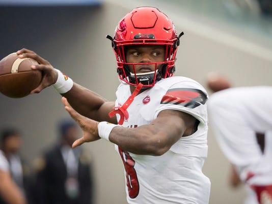 Louisville Cardinals quarterback Lamar Jackson (8) warms up before the start of the TaxSlayer Bowl NCAA college football game against the Mississippi State Bulldogs, Saturday, Dec. 30, 2017, in Jacksonville, Fla. (AP Photo/Stephen B. Morton)