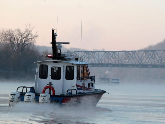 A file photo shows a Boone County Water Rescue boat in action just after dawn on the Ohio River. The agency is continuing recovery efforts for Whitney Crank, 31, of Erlanger, who Kentucky officials say went missing May 18 on the Ohio River near the I-75 Brent Spence Bridge.