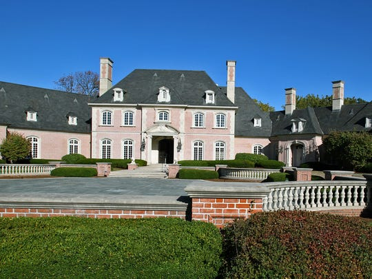 Forrest and Charlotte Lucas purchased the old Hilbert mansion in Carmel, Ind., for $3 million, much less than the original $20 million asking price.