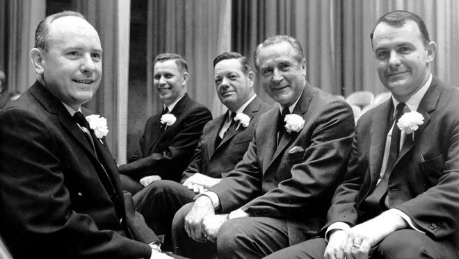 Carnations and broad grins were apparent on Jan. 2, 1964, as the reins of municipal government passed to a new City Commission. Sworn into office at The Auditorium were (from left) Mayor William B. Ingram Jr., Commissioner of Public Works Pete Sisson, Commissioner of Fire and Police Claude A. Armour, Commissioner of Finances and Institutions James E. Moore and Commissioner of Public Service Hunter Lane Jr.