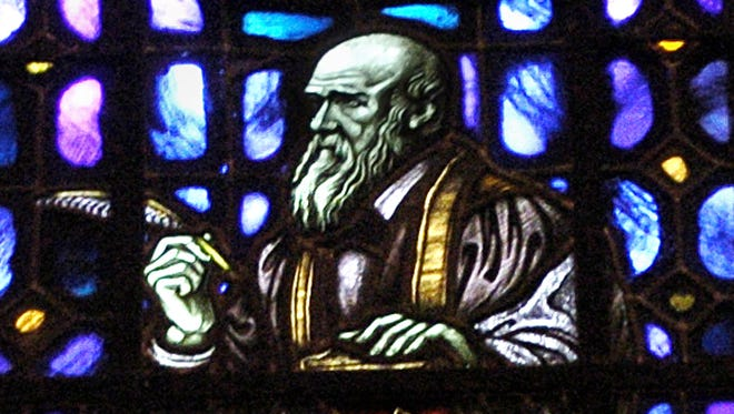 Charles Darwin, father of the evolution theory, is shown on a stained glass window at Fountain Street Church in Grand Rapids, Mich.