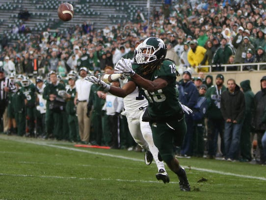Michigan State's Felton Davis III makes a touchdown