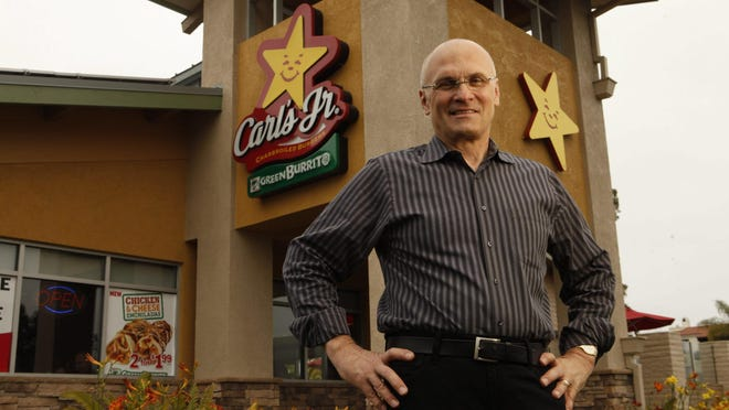 Andrew Puzder, who has been nominated by President Donald Trump to be secretary of labor, stands in front of one of his restaurants in June 2011.