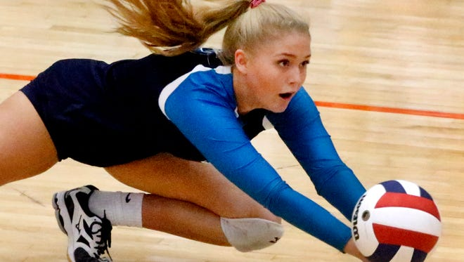 Siegel's Emily Bishop (2) dives for the ball during the first round of the TSSAA Class AAA State Girls' Volleyball Tournament against Tennessee High School, on Tuesday, Oct. 17, 2017, at Blackman.
