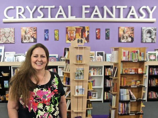 Joy Brown Meredith, owner of Crystal Fantasy in downtown Palm Springs, poses for a photograph on Monday, Nov. 23, 2015.