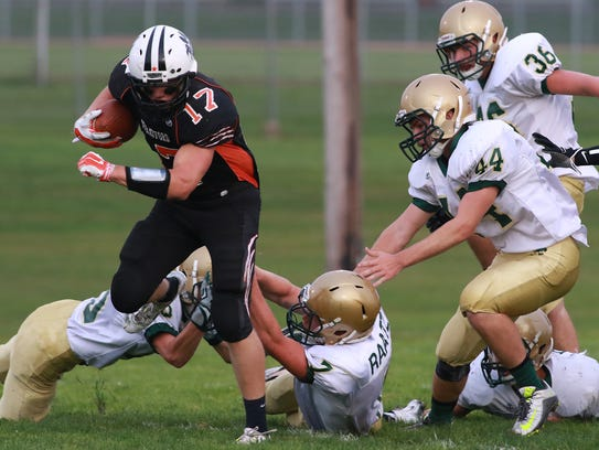 Running back Taylor Krall breaks free from Colby tacklers