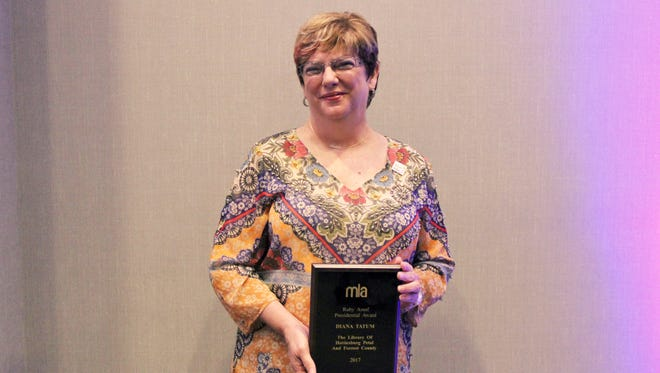 Dee Tatum shows off the Ruby Assaf Presidential Award presented to her Oct. 20 by the Mississippi Library Association for being an outstanding library volunteer.