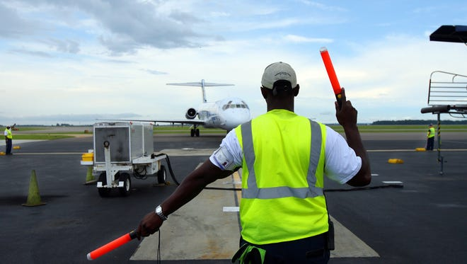 Sept. 17, 2009 -- Photo by Alan Spearman. Lineman Mario Wooten guides in a jet carrying 117 casino visitors at the Tunica Municipal Airport. In 2008 59,747 people arrived in Tunica at the airport, up significantly from the 14,500 visitors in 2006.