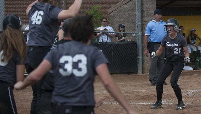 Egg Harbor Township's Nicole Wisser scores the winning run against East Brunswick in the eighth inning of the state Group 4 semifinal on Tuesday at Rowan University.