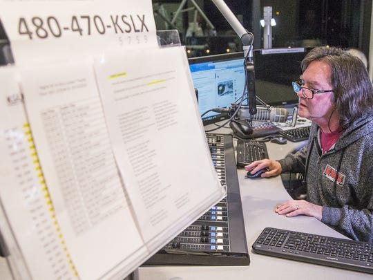 KSLX radio personality Russ Egan works during his show