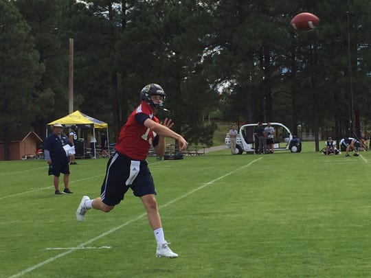 Case Cookus throws a pass during Northern Arizona's