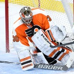 Michal Neuvirth makes one of his 30 saves to shut out