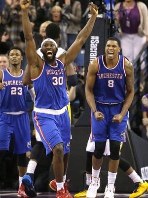Reggie Evans, center, and Rudy Gay, right, celebrate after the Kings scored to take a one-point lead in the closing moments in overtime on their way to beating the Indiana Pacers 102-101.
