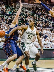 MSU walk-on Greg Roy  passes around Illinois' Cameron Liss in the final seconds of the Spartans' win over Illinois Thursday night. Roy played the final 20 seconds.