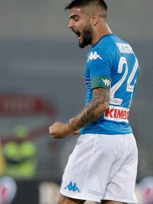 Napoli's Lorenzo Insigne celebrates his side's 1-0 over Roma, at the end of a Serie A soccer match at the Rome Olympic Stadium, Saturday, Oct. 14, 2017. (AP Photo/Andrew Medichini)