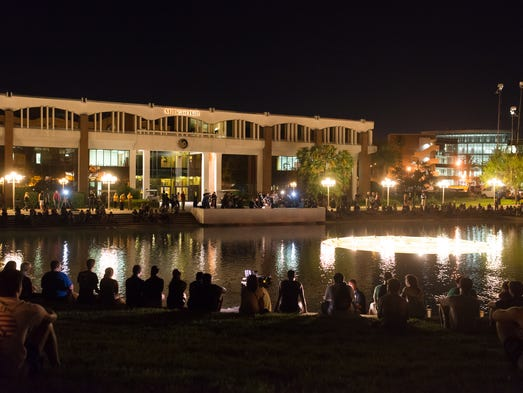 Hundreds of students gathered around the Reflecting Pond to mourn the death of journalist Steven Sotloff.