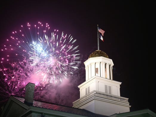 Fireworks are seen over the Old Capitol on Saturday in downtown Iowa City.