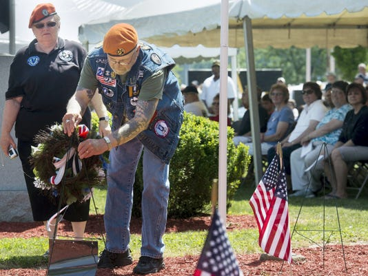Members of Veterans of Vietnam War Post 35, Juanita Klein and Richard Ross, place a wreath Monday during the Memorial Day Service at Veterans Memorial Park in York. This year marks the 50th anniversary of when U.S. combat operations began in the Vietnam.