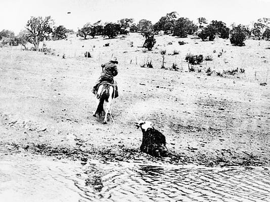 Willard Bates 54 pulling a cow out of the mud at Frijole Tank on the Panama Ranch in 1930. Photo from New Mexico Northern Guadalupe collection of Tura Bates McWilliams via Dr. Jerry Cox.