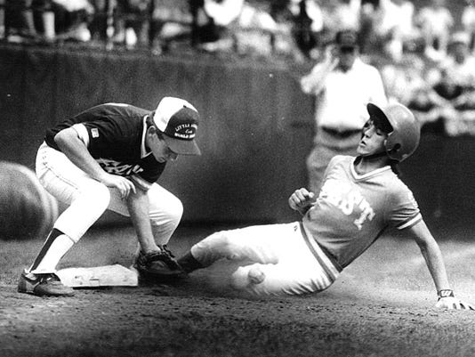 Shippensburg third baseman Mike Ocker, left, tries to tag Eddie Zamora of Cypress, Calif. during the 1990 Little League U.S. championship game.