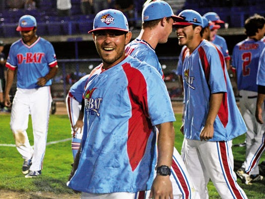 D-BAT Gallegos manager Roberto Gallegos laughs after getting soaked with water after his team won the title game of the Connie Mack World Series at Ricketts Park in Farmington.