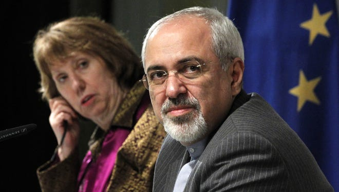 European Union foreign policy chief Catherine Ashton, left, and Iranian Foreign Minister Mohammad Javad Zarif attend a news conference at the end of the Iranian nuclear talks in Geneva on Nov. 10, 2013.