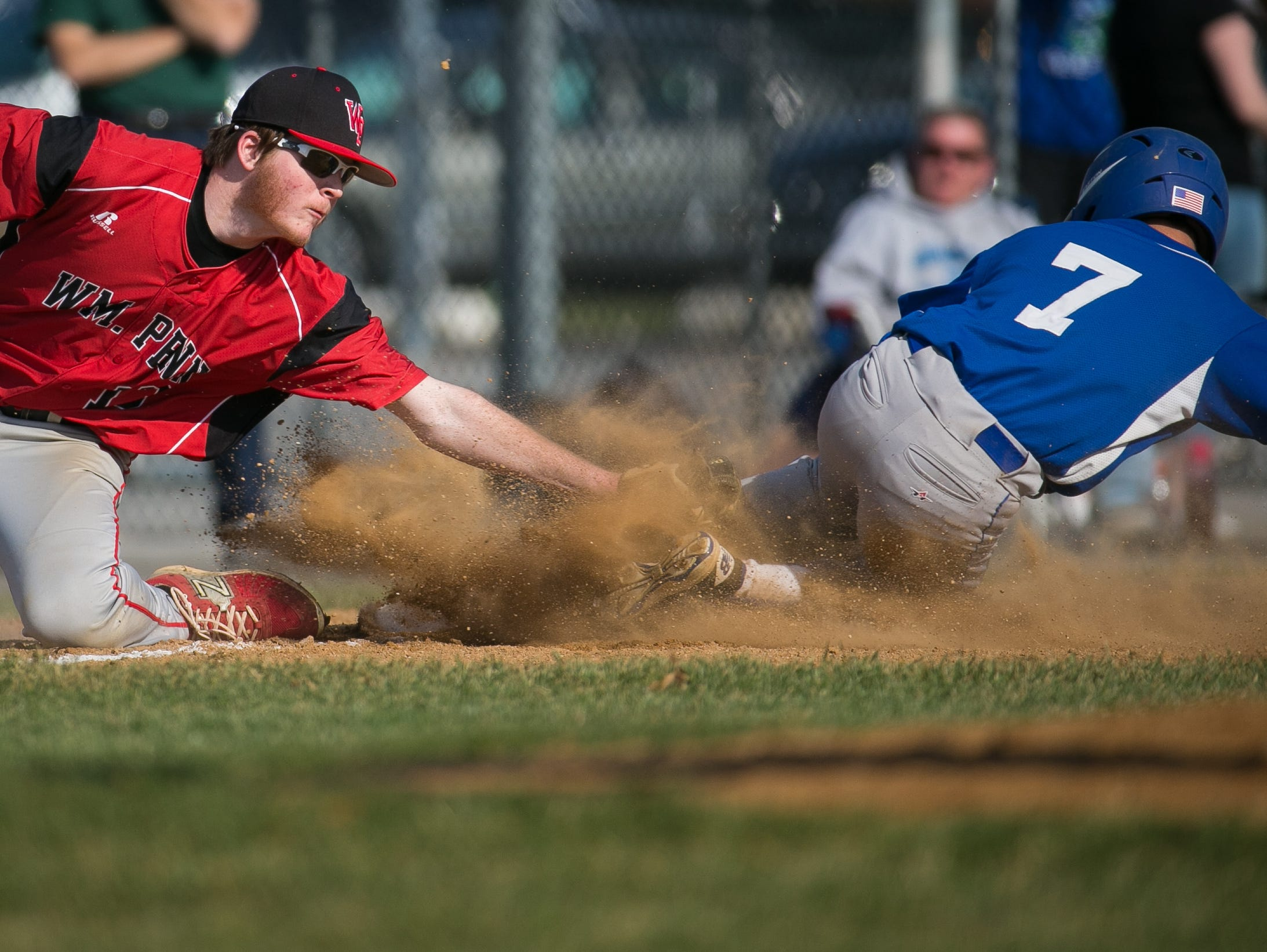 St. Georges outfielder Dominic Durante slides safely into third as William Penn third baseman Matthew North is late with the tag.