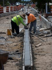 Workers prepare a concrete curb visible along SE 47th Terrace in downtown Cape Coral as part of the streetscape rennovation process.