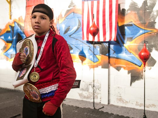 Antwoine Dorm Jr., 11, of York City, poses with his