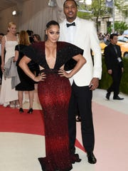 La La Anthony, left, and Carmelo Anthony arrive at