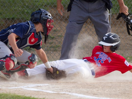 TriTown catcher Devin Russell tags out Randolph West's Eric Recchia as he slides in to home plate in the first inning of the District 1 Little League baseball final in Randolph on Monday night, July 10, 2016. Randolph won, 4-3.