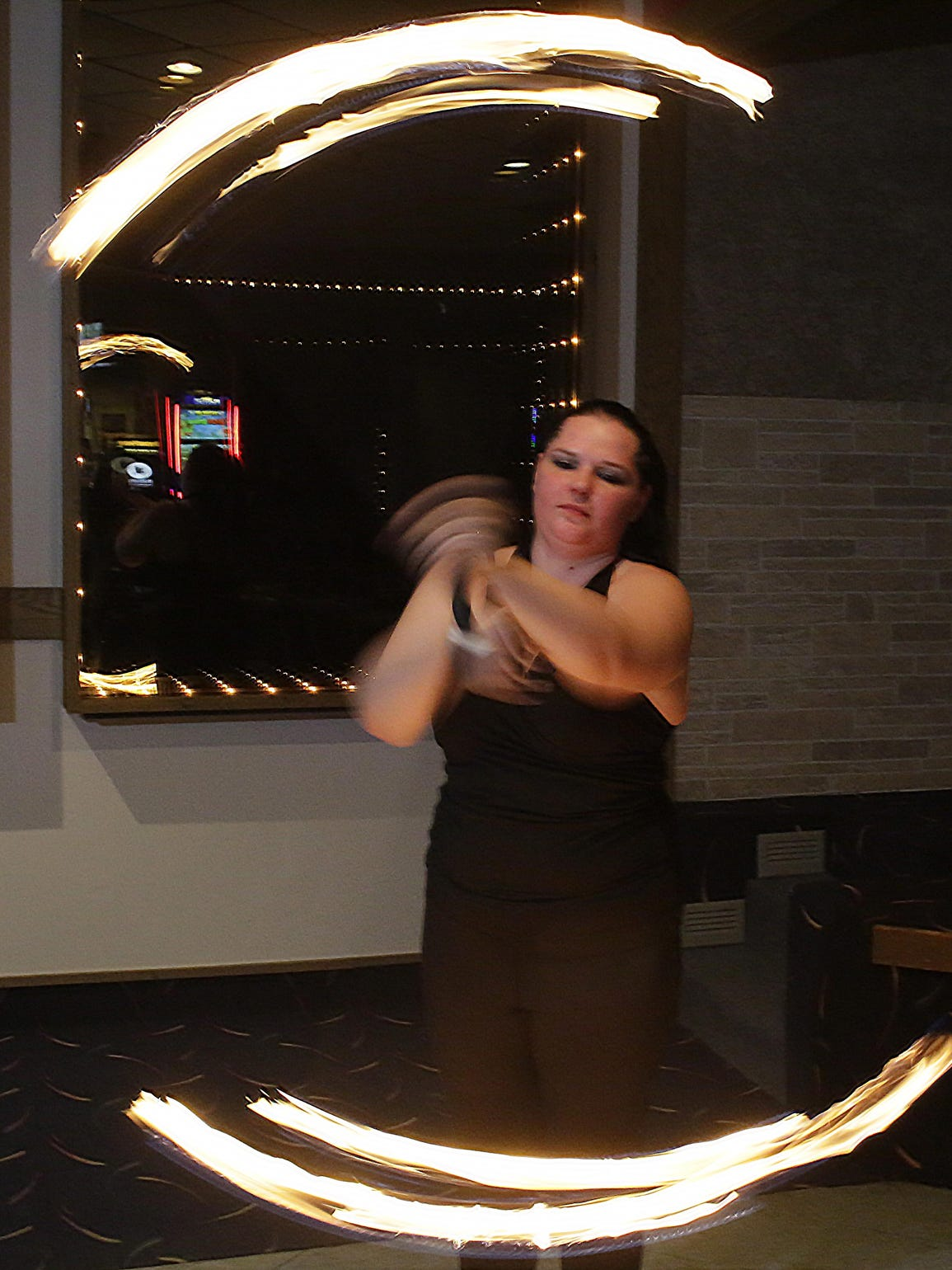 Valerie Ringwell of Sheboygan, works a barbell of fire