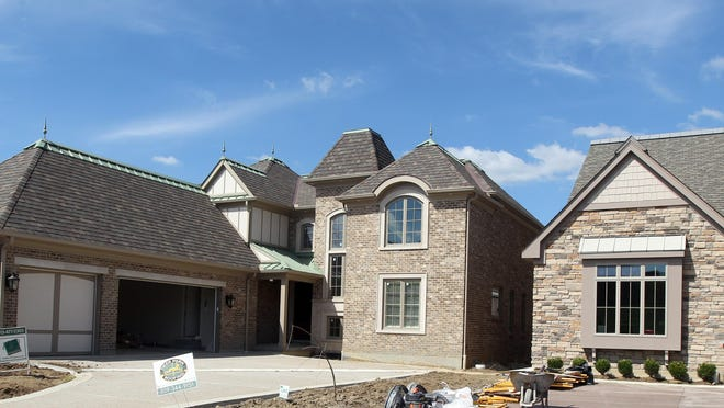 Ground level view of southern face of a home in the Manhattan Harbour development, Dayton. The development will be the site of the Northern Kentucky Homebuilders Association HomeFest, 10/3-10/18. (IT WAS VERY DIFFICULT TO MAKE A GROUND LEVEL VIEW OF THIS DEVELOPMENT AS THE STREET IS VERY CLOSE TO THE HOMES AND BOTH SIDE ARE LINED WITH VEHICLES, MANY BOX AND LARGE TRUCKS. JUST FYI. NO EXCUSES, AN EXPLANATION)