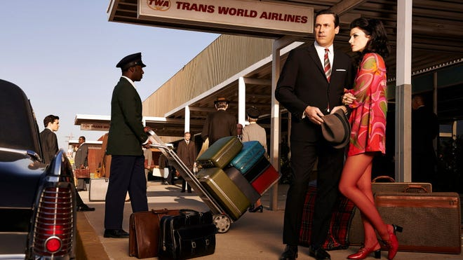 """1960s: Times change for Megan and Don Draper (Jessica Pare and Jon Hamm)  on AMC's """"Mad Men."""""""
