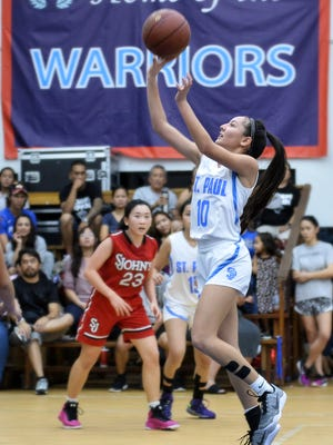 Haley Senne of the St. Paul Warriors takes an uncontested shot in the lane in an Independent Interscholastic Athletic Association of Guam Girls Basketball League playoff match against the St. John's Knights at St. Paul on Nov. 26, 2016. League MVP Senne led all scores with 15 points in the winning effort.