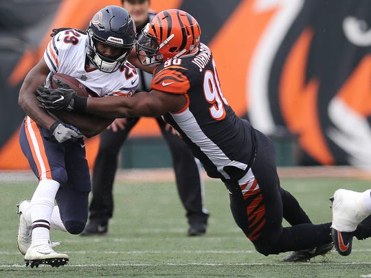 Cincinnati Bengals defensive end Michael Johnson (90) tackled Chicago Bears running back Tarik Cohen (29) during the Week 14 NFL game between the Chicago Bears and the Cincinnati Bengals, Sunday, Dec. 10, 2017, at Paul Brown Stadium in Cincinnati. Chicago won 33-7.