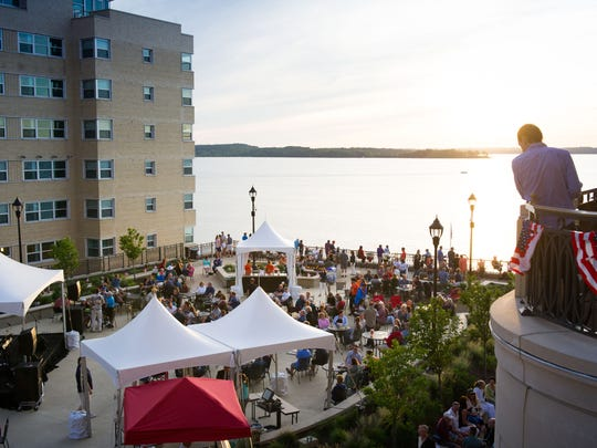 Guests and Madison residents enjoy a beautiful sunset and live music over Lake Mendota during The Edgewater's Fourth Fest, held each July in Madison.