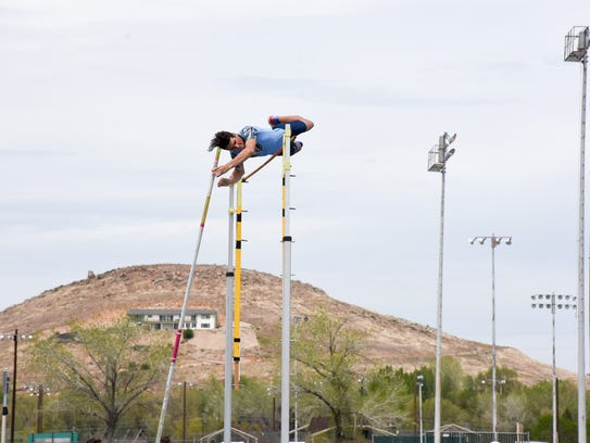 Reed;s Corban Conacour pole vaults Saturday.