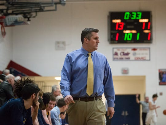 Port Huron Northern coach Brian Jamison watches the action during a basketball game Wednesday, March 2, 2016 at St. Clair High School.