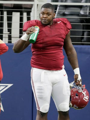 Alabama defensive lineman Jarran Reed takes a break during practice Dec. 28, 2015, in Arlington, Texas.