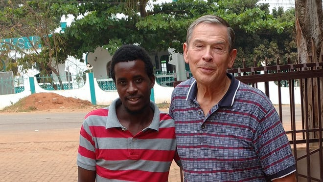Ronald Overmyer with his translator, Mateus Bernabe, in Mozambique. Mozambique's official language is Portugal, but some of the farmers in the area speak only tribal languages.