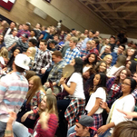 Pine View High School students celebrate after a basketball game.