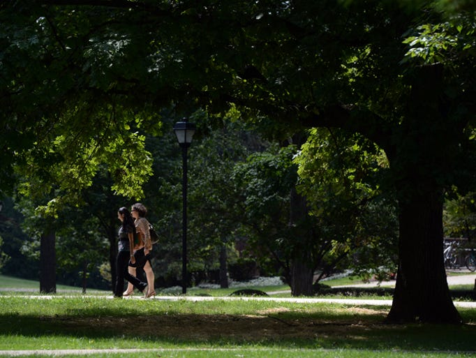 Students walk on the campus of Earlham College as classes resume Wednesday, Aug. 27, 2014.