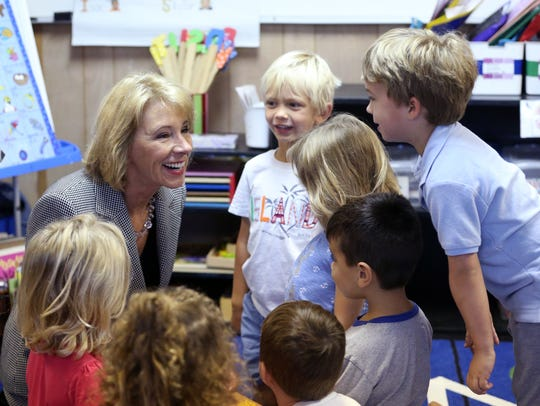 U.S. Secretary of Education Betsy DeVos (left) visits